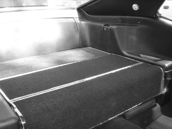 View of folded rear seat in a 1969 or 1970 Ford Mustang
