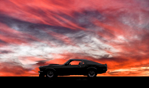 Ford Mustang supercar against a sunset sky