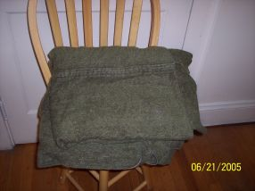 Photo of the original green Army surplus wool blanket carried in a real life super car.